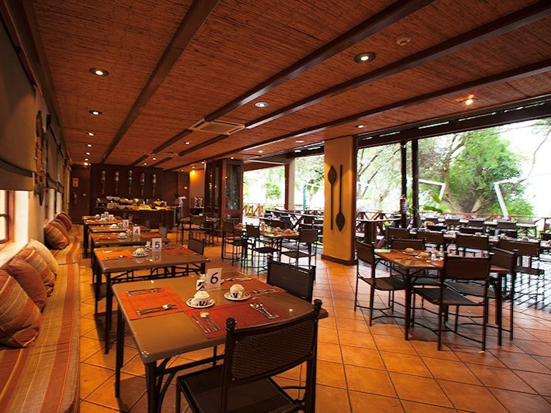 chobe-marina-lodge-chobe-national-park-accommodations-botswana-destinations-journey-in-style-southern-africa-covered-dining-area