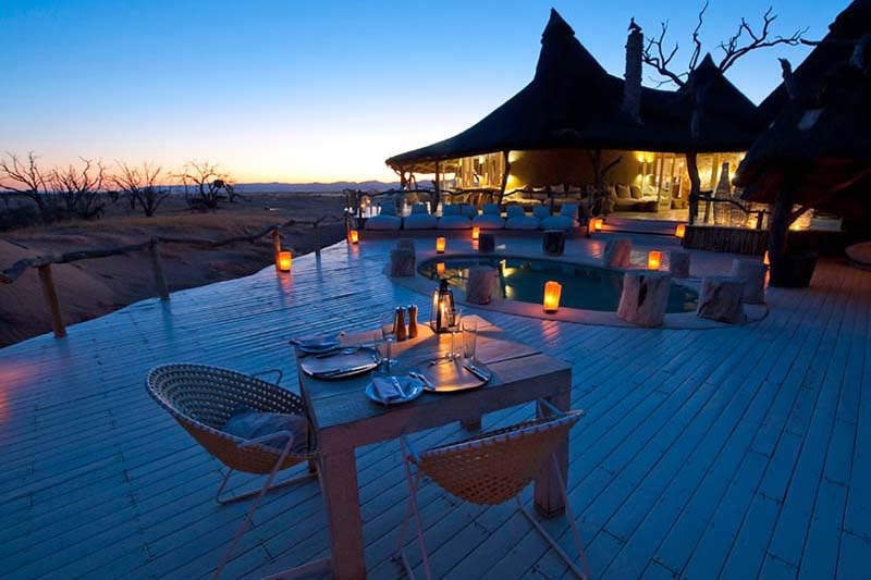 wings over namibia sossusvlei-region-packages-namibia-destinations-journey-in-style-southern-africa-dining-pool-deck-at-little-kulala